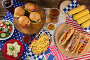 Hot dogs and burgers on wooden table with 4th july theme, фото № 26569123, снято 10 февраля 2017 г. (c) Wavebreak Media / Фотобанк Лори