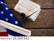 Купить «American flag with rolled-up of constitution document», фото № 26569543, снято 10 февраля 2017 г. (c) Wavebreak Media / Фотобанк Лори