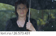 Купить «Woman at black clothes under umbrella at rain», видеоролик № 26573431, снято 24 июня 2017 г. (c) Илья Шаматура / Фотобанк Лори