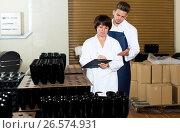 Купить «Employees checking number of wine bottles», фото № 26574931, снято 10 ноября 2016 г. (c) Яков Филимонов / Фотобанк Лори