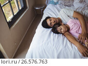 Купить «Father and daughter sleeping together in bedroom», фото № 26576763, снято 20 марта 2017 г. (c) Wavebreak Media / Фотобанк Лори