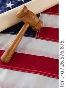 Купить «Gavel and rolled-up document arranged on American flag», фото № 26576875, снято 10 февраля 2017 г. (c) Wavebreak Media / Фотобанк Лори