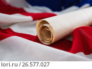 Купить «American flag with rolled-up of constitution document», фото № 26577027, снято 10 февраля 2017 г. (c) Wavebreak Media / Фотобанк Лори