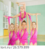 Купить «Girls carrying out routine in rhythmic gymnastics», фото № 26579899, снято 16 апреля 2017 г. (c) Сергей Новиков / Фотобанк Лори