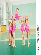 Купить «Rhythmic gymnasts group showing their performance», фото № 26579907, снято 16 апреля 2017 г. (c) Сергей Новиков / Фотобанк Лори