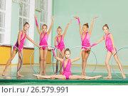 Купить «Rhythmic gymnastic team performing hoop routine», фото № 26579991, снято 16 апреля 2017 г. (c) Сергей Новиков / Фотобанк Лори