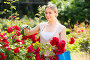 positive young woman working with bush roses with horticultural tools in garden, фото № 26580159, снято 27 июня 2017 г. (c) Яков Филимонов / Фотобанк Лори