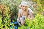 Woman working in garden using horticultural instruments on summer day, фото № 26580171, снято 27 июня 2017 г. (c) Яков Филимонов / Фотобанк Лори