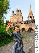 Купить «Счастливая женщина турист делает селфи на фоне православного храма», фото № 26582463, снято 24 июня 2017 г. (c) Эдуард Паравян / Фотобанк Лори