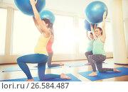 Купить «happy pregnant women exercising with ball in gym», фото № 26584487, снято 5 марта 2016 г. (c) Syda Productions / Фотобанк Лори