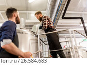 Купить «men working at craft brewery or beer plant», фото № 26584683, снято 24 марта 2017 г. (c) Syda Productions / Фотобанк Лори