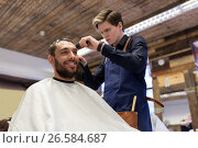 Купить «man and barber with trimmer cutting hair at salon», фото № 26584687, снято 6 апреля 2017 г. (c) Syda Productions / Фотобанк Лори