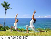 Купить «couple making yoga in low lunge pose outdoors», фото № 26585107, снято 6 августа 2014 г. (c) Syda Productions / Фотобанк Лори