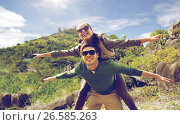 Купить «happy couple with backpacks having fun outdoors», фото № 26585263, снято 27 мая 2016 г. (c) Syda Productions / Фотобанк Лори