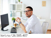 Купить «businessman in glasses sitting at office computer», фото № 26585407, снято 9 марта 2017 г. (c) Syda Productions / Фотобанк Лори