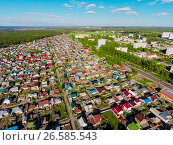 Купить «Panorama aerial view shot on cottage village in forest, suburb, village», фото № 26585543, снято 26 мая 2017 г. (c) Сергей Тимофеев / Фотобанк Лори