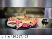 Купить «Close up of hamburgers served on table», фото № 26587463, снято 14 ноября 2016 г. (c) Wavebreak Media / Фотобанк Лори