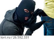 Купить «Stealing phone from the back pocket jeans in the mask», фото № 26592331, снято 1 октября 2016 г. (c) Константин Лабунский / Фотобанк Лори