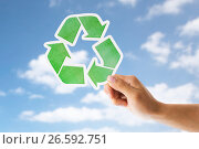 Купить «close up of hand with green recycle sign over sky», фото № 26592751, снято 3 июня 2016 г. (c) Syda Productions / Фотобанк Лори