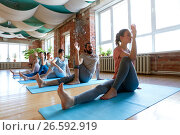 Купить «group of people doing yoga at studio», фото № 26592919, снято 5 марта 2017 г. (c) Syda Productions / Фотобанк Лори