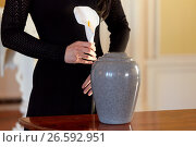 Купить «woman with cremation urn at funeral in church», фото № 26592951, снято 20 марта 2017 г. (c) Syda Productions / Фотобанк Лори