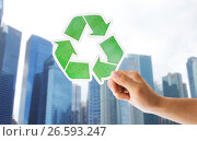 Купить «close up of hand with green recycle sign in city», фото № 26593247, снято 3 июня 2016 г. (c) Syda Productions / Фотобанк Лори