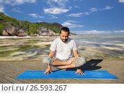 Купить «man making yoga in scale pose outdoors», фото № 26593267, снято 7 августа 2016 г. (c) Syda Productions / Фотобанк Лори
