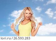 Купить «happy young woman with blonde hair over blue sky», фото № 26593283, снято 20 апреля 2017 г. (c) Syda Productions / Фотобанк Лори
