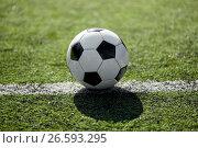 Купить «soccer ball on football field marking line», фото № 26593295, снято 18 сентября 2016 г. (c) Syda Productions / Фотобанк Лори