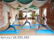Купить «group of people doing yoga warrior pose at studio», фото № 26593343, снято 5 марта 2017 г. (c) Syda Productions / Фотобанк Лори