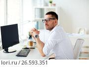 Купить «businessman in glasses sitting at office computer», фото № 26593351, снято 9 марта 2017 г. (c) Syda Productions / Фотобанк Лори