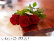 Купить «red roses on bench at funeral in church», фото № 26593367, снято 20 марта 2017 г. (c) Syda Productions / Фотобанк Лори