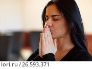 Купить «close up of unhappy woman praying god at funeral», фото № 26593371, снято 20 марта 2017 г. (c) Syda Productions / Фотобанк Лори