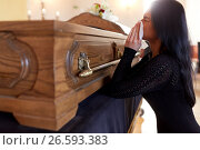 Купить «woman with coffin crying at funeral in church», фото № 26593383, снято 20 марта 2017 г. (c) Syda Productions / Фотобанк Лори