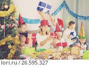 Купить «Teenagers exchanging Christmas gifts», фото № 26595327, снято 15 ноября 2018 г. (c) Яков Филимонов / Фотобанк Лори