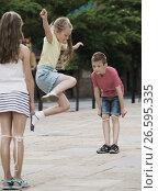 Купить «Kids skipping on elastic rope», фото № 26595335, снято 14 декабря 2017 г. (c) Яков Филимонов / Фотобанк Лори