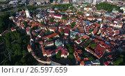 Купить «Полет вверх над старым городом в Таллине. Башня Олафа. Эстония», видеоролик № 26597659, снято 29 июня 2017 г. (c) Кекяляйнен Андрей / Фотобанк Лори
