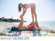 Купить «Portrait of playful couple enjoying at beach», фото № 26602251, снято 17 января 2017 г. (c) Wavebreak Media / Фотобанк Лори