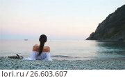 Купить «Young woman enjoying vacation on the beach in european vacation on the Ligurian coast», видеоролик № 26603607, снято 19 июня 2017 г. (c) Дмитрий Травников / Фотобанк Лори