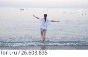 Купить «Young woman enjoying vacation on the beach in european vacation on the Ligurian coast», видеоролик № 26603835, снято 21 июня 2017 г. (c) Дмитрий Травников / Фотобанк Лори