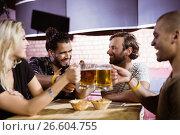 Купить «Happy friends toasting beer mugs at nightclub», фото № 26604755, снято 7 марта 2017 г. (c) Wavebreak Media / Фотобанк Лори
