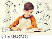 Купить «smiling student boy writing to notebook at home», фото № 26607351, снято 24 октября 2015 г. (c) Syda Productions / Фотобанк Лори