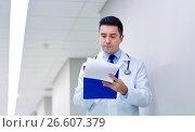 Купить «doctor with clipboard at hospital corridor», фото № 26607379, снято 3 декабря 2015 г. (c) Syda Productions / Фотобанк Лори