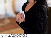 Купить «close up of woman with wipe at funeral in church», фото № 26607683, снято 20 марта 2017 г. (c) Syda Productions / Фотобанк Лори
