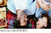 Купить «Couple lying on picnic blanket», видеоролик № 26610851, снято 18 октября 2018 г. (c) Wavebreak Media / Фотобанк Лори