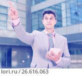 Businessman pointing at something. Стоковое фото, фотограф Яков Филимонов / Фотобанк Лори