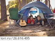 Купить «Portrait of couple relaxing in tent», фото № 26616495, снято 9 марта 2017 г. (c) Wavebreak Media / Фотобанк Лори