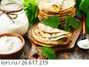 Купить «Pancakes with nettle», фото № 26617219, снято 3 мая 2017 г. (c) Надежда Мишкова / Фотобанк Лори