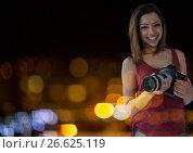 Купить «Photographer in front of lights bokeh», фото № 26625119, снято 20 марта 2019 г. (c) Wavebreak Media / Фотобанк Лори