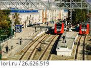 """Купить «Сочи, электропоезда """"Ласточка"""" на железнодорожном вокзале», фото № 26626519, снято 7 февраля 2014 г. (c) glokaya_kuzdra / Фотобанк Лори"""